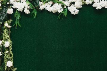 Stylish wedding green photo zone with flowers, free space