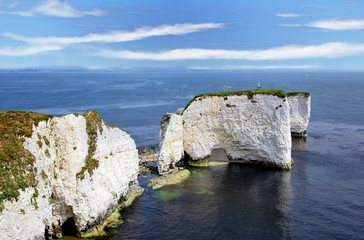 The beautiful grass covered white chalk cliffs of Old Harry Rocks in Dorset