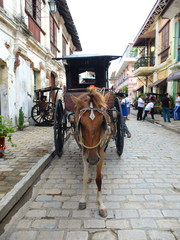 VIGAN, PHILIPPINES - JULY 25, 2015 : A Kalesa (or Horse Carriage) in Historic Town of Vigan..Vigan is a UNESCO World Heritage Site in that it is one of the few Spanish colonial town.