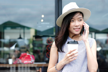 Young asian woman talking smartphone in city outdoors background, people on phone, lifestyle