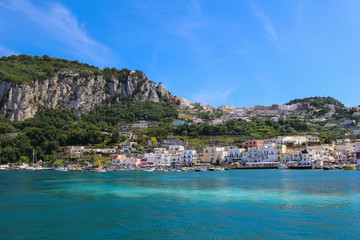 Beautiful island of Capri with clear blue waters and busy shore