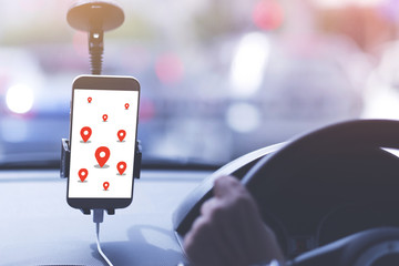 A man is driving public taxi using smart phone go to pointed destination by smart phone. Technology and transportation concept.