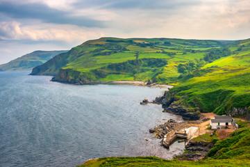 Scenic landscape of green coastline at Torr Head, Antrim, Northern Ireland. Causeway coastal route Wall mural