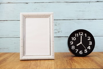 black alarm clock and space photo frame