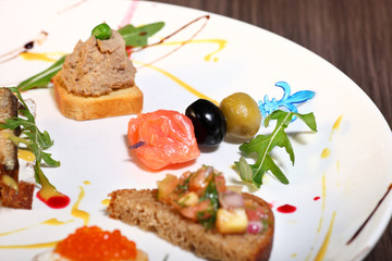Canapes with salmon red caviar on a wooden background.Toast
