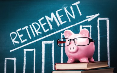 Piggy Banks and Retirement Word on Chalkboard