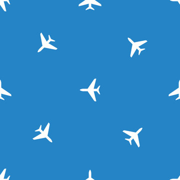 Seamless airplane pattern. Flying plane on blue background.