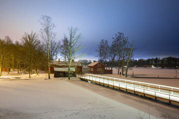 Winter scenery with frozen lake at night, Sweden