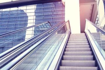 ascending escalator in a public transport area