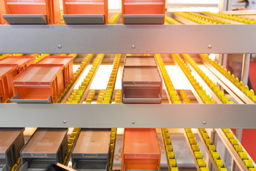 Plastic boxes on the roller conveyor. Modern warehouse equipment.