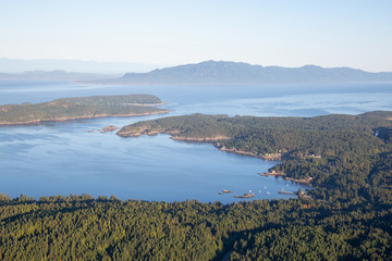 Aerial view of Halfmoon Bay during a sunny summer day. Taken in Sunshine Coast, BC, Canada.