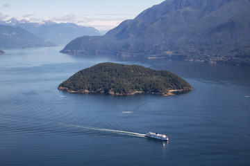 Fototapete - Aerial view of a ferry boat traveling in Howe Sound during a sunny summer day. Taken North of Vancouver, BC, Canada.