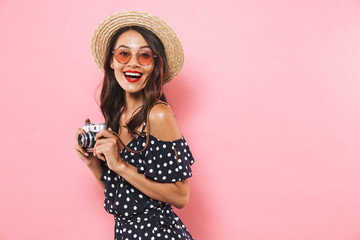 Side view of Happy woman in straw hat and sunglasses