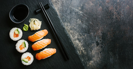 Fotobehang Sushi bar Sushi served on plate on dark table