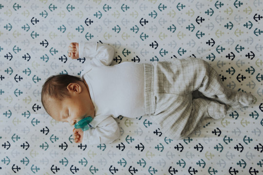 Peaceful baby sleeping in a crib