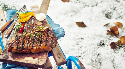 Delicious barbecued t-bone steak with herbs Wall mural