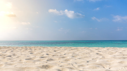 Empty tropical beach background. Horizon with sky and white sand