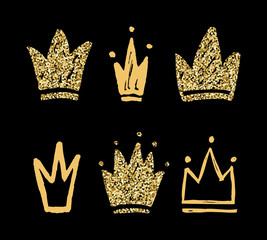 Vector set of abstract golden silhouettes of crowns. Hand drawn grunge icons isolated