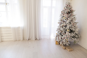 snowy Christmas tree with gifts for the new year