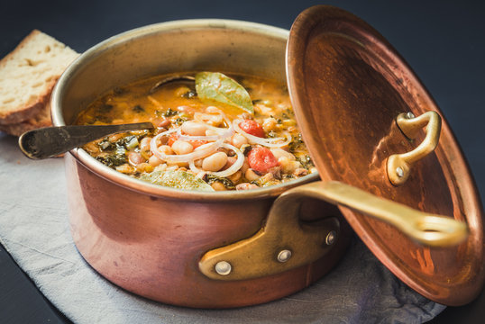 Soup with different vegetables and legumes, typical tuscan soup, ribollita.