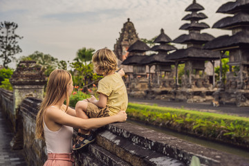 Mom and son tourists in Traditional balinese hindu Temple Taman Ayun in Mengwi. Bali, Indonesia Traveling with children concept