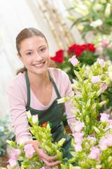 Smiling florist sorting flowers