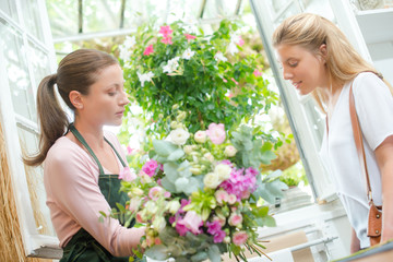Florist presenting bouquet to customer