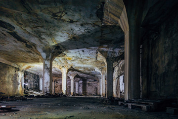 Dark and creepy interior of underground industrial hall at abandoned factory