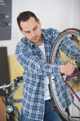 man fixing bicycle gears mechanism