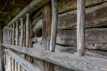 Wooden fence on old wooden barn