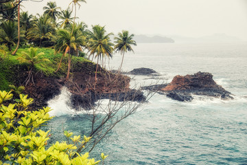 Cliffs, waves and ocean at rollas island in sao tome and principe