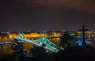Scenic night scape of Budapest. Danube river and Freedom bridge in backlight