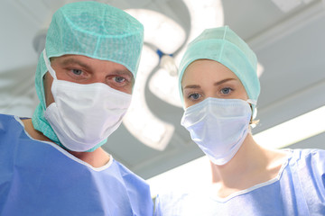 Male and female medical workers wearing masks