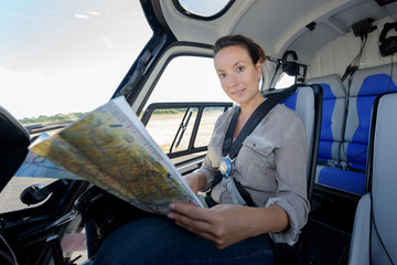 woman helicopter pilot reading map