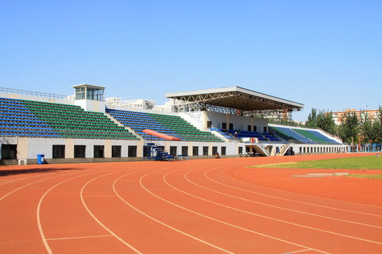 Red plastic runway stadium and rostrum