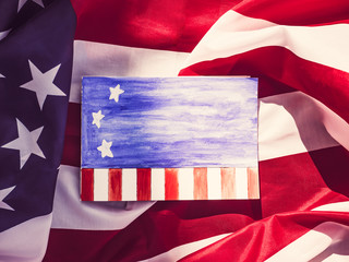 Blank page notepad for congratulations on holidays in the United States on the background of the American flag. Preparation for celebrating