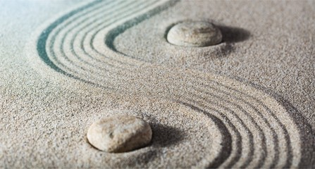 Foto op Plexiglas Stenen in het Zand Zen stones in the sand. Grey background