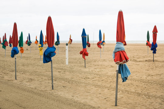 Closed Colorful Beach Umbrellas on an Overcast Day in Deauville, France