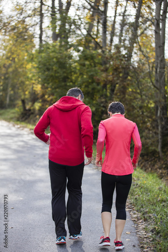 Running Free In Germanys Outdoor >> Young Couple Running On The Sunny Day In The Autumn Forest Of The
