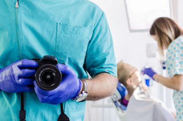 Dentist holding camera