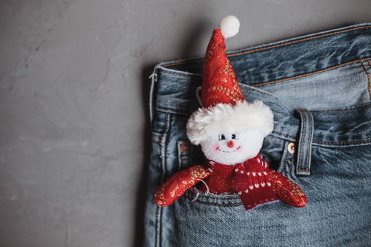 Moscow, Russia - 08 30 2018:Merry Christmas and a happy New Year with snowman in the jeans pocket, copy space