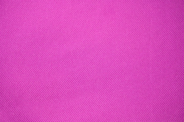 Pink fabric textured background. Sports pink clothing fabric jersey textured.