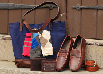 A leather bag with socks, wallets, shoes and other genuine leather goods.