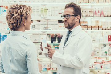 Pharmacist counseling Female Customer in Drugstore