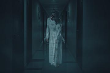 Scary female ghost walks in the hotel corridor Wall mural