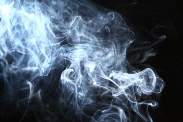 lovely flowing glowing bright smoke on heavy black background.