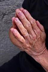 Hands in prayer, an old woman praying. old female hands praying