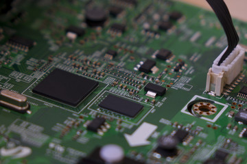 Lcd tv electronic circuit. Green color, faded at the sides.