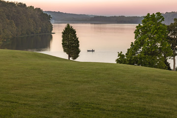 Small Fishing Boat on Acton Lake in Hueston Woods State Park, Ohio at Sunrise