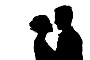 Couple silhouettes of kissing people